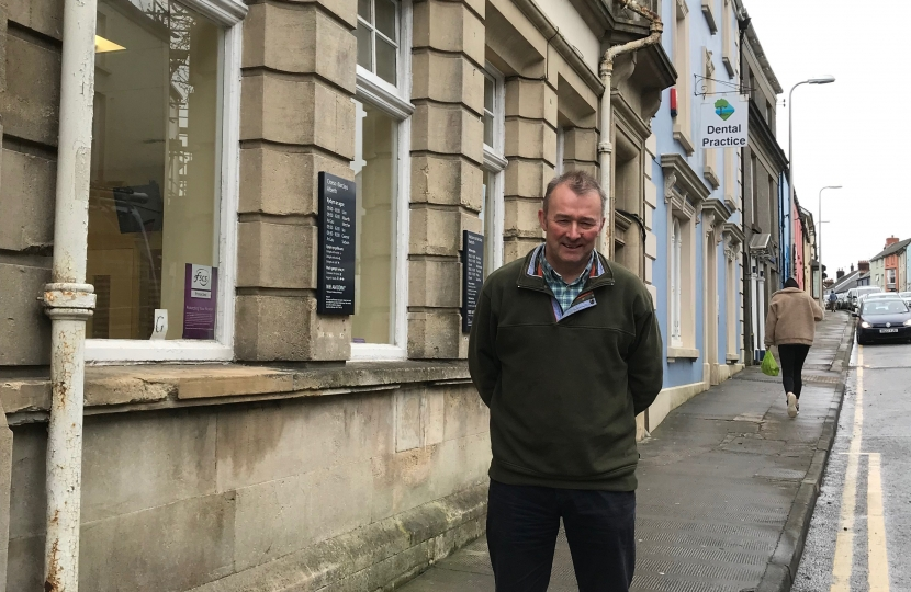 Simon Hart MP outside his local Barclays branch in St James Street Narberth which is closing at the end of June.