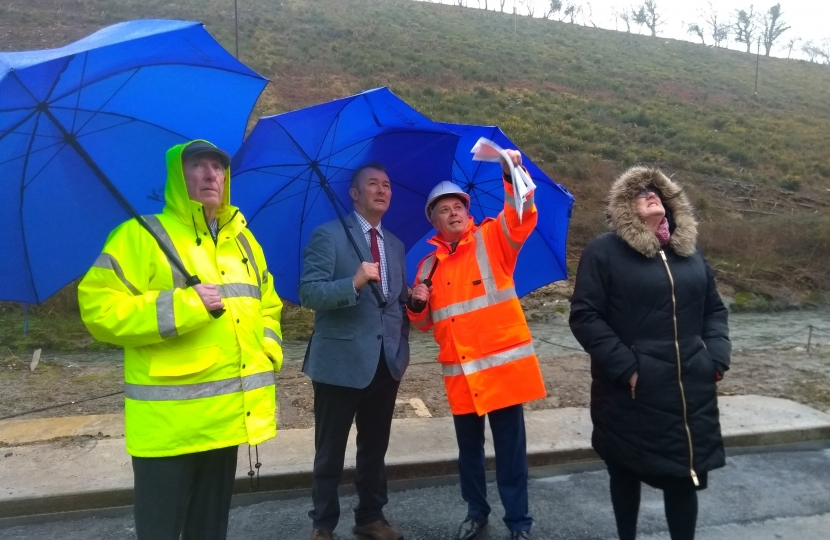 Simon Hart MP inspects the clear up on the A484