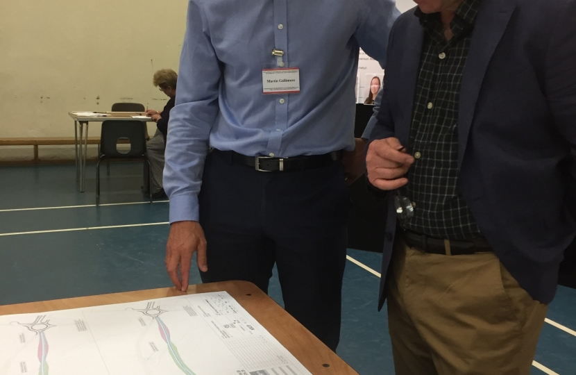 Simon Hart MP is pictured at the public exhibition for the latest Redstone Cross plans with Martin Gallimore, A40 public liaison officer.