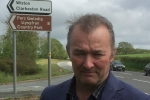 Simon Hart MP pictured at the Llysyfran Country Park sign on the A40 near Slebech.  The attraction has been closed since last year and will remain closed for some time to come.